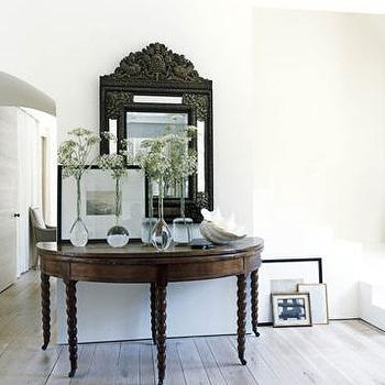 House Beautiful - entrances/foyers - console table, glass vases, wood floors, half moon table, half moon console table,  Jumbo large entry console