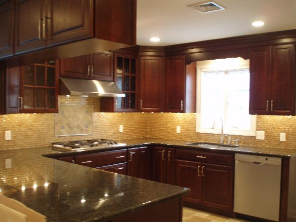 kitchens - cherry cabinets, cherry kitchen cabinets, granite countertops, glass tiles, glass tile backsplash, U shaped kitchen, peacock green granite, peacock green granite counters, peacock green granite countertops,