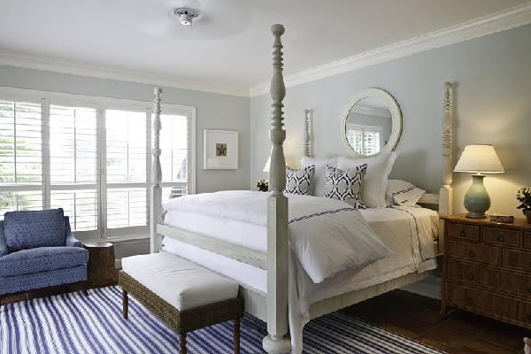 bedrooms - pale blue round mirror four poster bed striped rug  blues done right (Phoebe Howard designs)  gray poster bed, striped blue rug, nightstands,