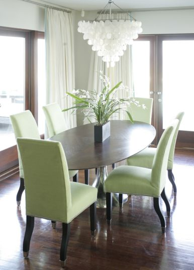 Bold Dining Room Oval Table Green Chairs And Capiz Chandelier