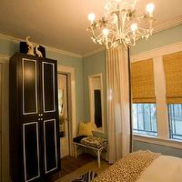 Turquoise LA - bedrooms - soft blue walls, chandelier, zebra print, black and white armoire, bedroom armoire, turquoise walls, turquoise blue walls, tole chandelier, white tole handelier, cheetah blanket,