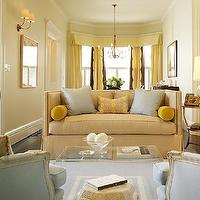 Palmer Weiss - living rooms: sofa, Lucite, table, Greek, key, rug, blue, gold, living room,  Sofa with nailhead trim, yellow and blue silk pillows,