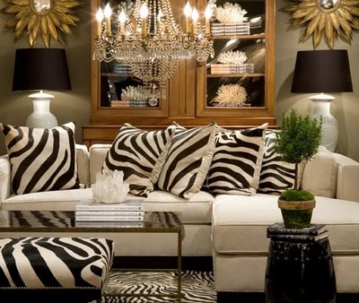 living rooms - zebra pillows, zebra bench, gold sunflower mirrors,  Sarah Kaplan Dovecoat Such a fun chic modern living room with pops of zebra!