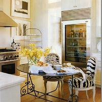 kitchens - zebra print, wood and iron table, zebra chairs, zebra dining chairs, oval dining table, glass front fridge, glass front refrigerator,
