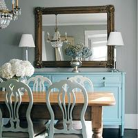 Morgan Harrison Home - dining rooms: turquoise, blue, brown, gray, gold, ornate, wall mirror, blue, buffet, cabinet, white, dining chairs, farmhouse dining table, turned legs, crystal chandelier, crystal, buffet, lamps, gray walls, paint color, dining room,