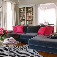 Kishani Perera - living rooms - velvet sofa, blue sofa, blue sectional sofa, blue velvet sofa, blue velvet sectional, blue velvet sectional sofa, acrylic coffee table, zebra rug, CB2 Peekaboo Clear Coffee Table,
