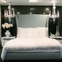 bedrooms: upholstered bed, chandelier black and white,  drama queen.  Coco Bed from Mogul.  blue wingback headboard bed and crystal chandeliers.