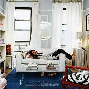 Domino Magazine - living rooms - blue rug, blue greek key rug, greek key rug, slipcovered sofa, , lucite coffee table,  Blue rug, white slipcovered