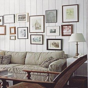 living rooms - art gallery, striped sofa, cozy sofa, comfy sofa,  beach house living room  paneled walls, eclectic art gallery, striped sofa