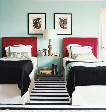 Domino Magazine - bedrooms - Pratt and Lambert - Lost Oasis - shared bedroom, twin headboards, red headboards, turquoise walls, antique brass nightstand, black blankets, striped rug, black and white rug, black and white striped rug,