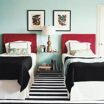Domino Magazine - bedrooms - shared bedroom, twin headboards, red headboards, turquoise walls, antique brass nightstand, black blankets, striped rug, black and white rug, black and white striped rug,