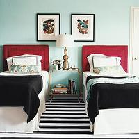 Domino Magazine - bedrooms - red, upholstered, headboard, black, white, striped, rug, ikat, turquoise, blue, red, bolster pillow, white, hotel, bedding, black, stitching, black, throw blankets, art, copper, lamp, brass, glass, top, accent table, turquoise blue walls,
