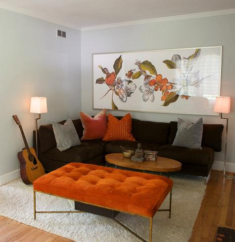 living rooms - sofa ottoman brown orange tufted ottoman rug orange gray pillows gray walls  Thanks to Designsponge and Heather Garrett Design.