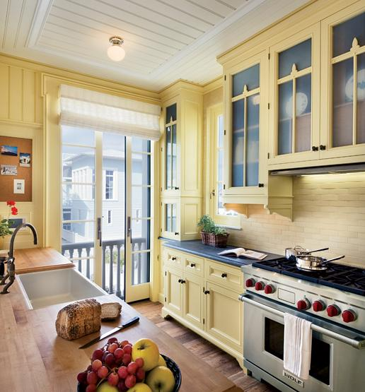 Yellow kitchen cabinets eclectic kitchen for Blue kitchen cabinets with yellow walls