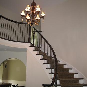 entrances/foyers - tan walls, tan paint, tan paint color, tan foyer walls, tan bedroom paint, tan bedroom paint color, winding staircase,  foyer