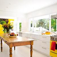 kitchens - yellow stove, farmhouse table, double sinks, double kitchen sinks,  Very cool. The yellow stove is great.