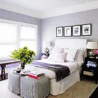 Elle Decor - bedrooms - gray, violet, purple, white, upholstered, headboard, bed, purple, velvet, throw blanket, bedding, silver, urn, lamps, ticking, gray, slip-covered, ottomans, Asian, wood, bench, black, white, photo gallery, glossy, black, step tables, nightstands, sisal, rug, purple walls, step table, step side table, black step table, black step side table, step nightstand, black step nightstand, step bedside table, black step bedside table, lacquer step table, black lacquer step table,