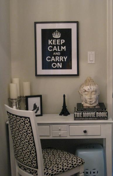 dens/libraries/offices - Benjamin Moore - barren plain - office nook white black geometric fabric chair white garden stool white desk silver candle holders