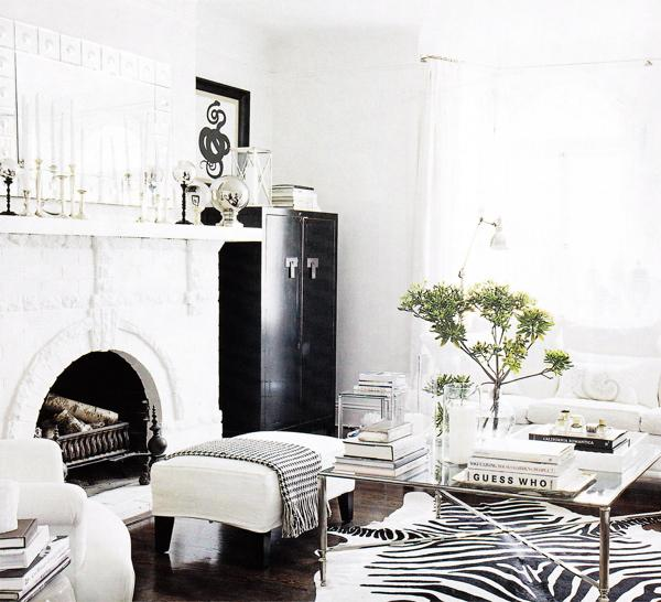 Elle Decor - living rooms - Zebra Cowhide Rug, black, white, stone, fireplace, white, bench, silver, glass, top, coffee table, Asian, zen, glossy, black, lacquer, cabinet, white, sofa, chair, glass, candle, holders, mirror, white, drapes, soft blue gray walls, paint color, living room,