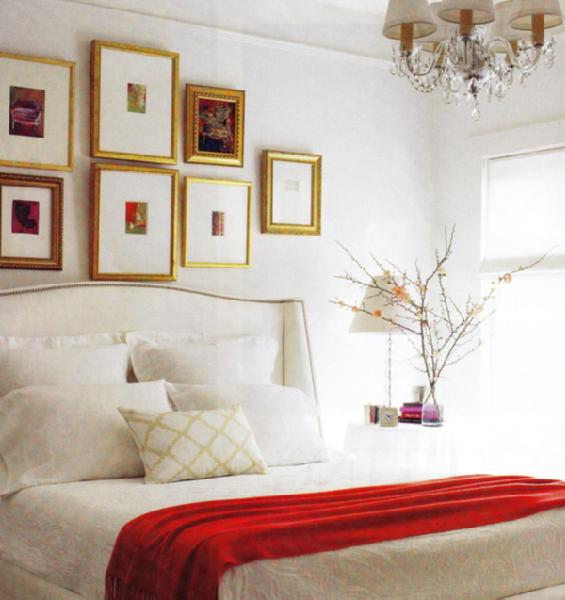 bedrooms - red gold white nailhead trim white wingback headboard gilt frames eclectic photo gallery gold leaf frames bedding basketweave pillow red cashmere throw blanket stacked ball glass lamp white linen roller shade crystal chandelier bedroom