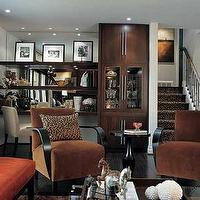 Candice Olson - living rooms - gray, brown, orange, velvet, accent, chairs, orange, leather, ottoman, bench, leopard, print, pillow, wood, coffee table, leather, floating, shelves, mirror, backsplash, blue, crushed, velvet, drapes, espresso, wood floors, built-ins, cabinets, gray blue walls, paint colors, floating desks, stained floating desks,