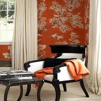living rooms - black and white chair, black and white arm chair, chinoiserie chair, orange wallpaper, chinoiserie wallpaper, chinoiserie chair,