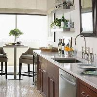 Phoebe Howard - kitchens - brown, tan, silver, gray galley, kitchen, chrome, pub table, gray, upholstered, stools, stainless, steel, floating shelves, sink, white, carrara, marble, countertops, counter top, faucet, ivory, linen, roman shades, mirror, tiles, cherry cabinets, cherry kitchen cabinets,