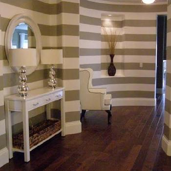 4 Men 1 Lady - entrances/foyers - console table, horizontal striped walls, curved foyer,  Striped walls. White console table with drawers, white