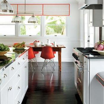 kitchens - molded plastic chairs, red dining chairs, red molded plastic chairs, farmhouse table, farmhouse dining table, stainless steel countertops, kitchen island with stainless steel top, island with stainless steel top, Clemson Double Pendant, Eames Molded Plastic Chair,