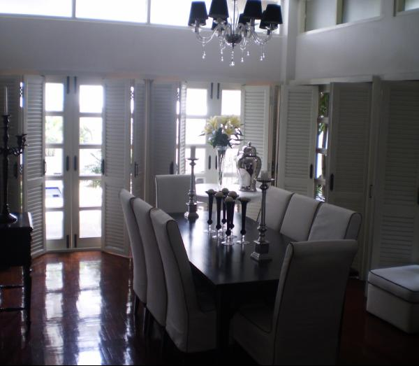 Silver Plantation Shutters In Dining Room
