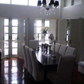 Monochrome Inc Interior Design - dining rooms - dining chairs, dining table, crystal chandelier, French doors, wood floors, silver, candlesticks, silver, ginger jars, louvered doors, louvered bi fold doors, 2 story dining room,