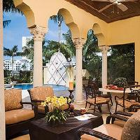 decks/patios - outdoor, wood, orange, pool, table, columns,  Out door living by the pool.