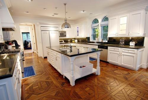kitchens - Yoke Pendant, wood floors, parquet wood floors, white kitchen cabinets with black countertops,  Tori Spelling  Parquet wood floors,