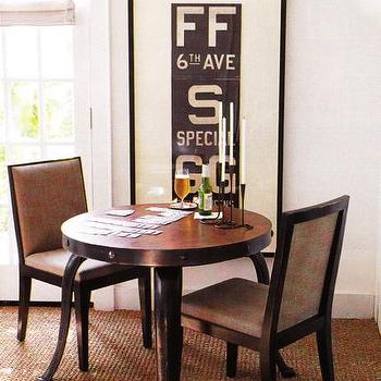 dining rooms - subway sign, vintage subway sign, game table,  Small, chic dining room  Framed antique subway sign, round claw foot dining table,