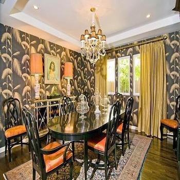dining rooms - oval dining table, black dining table, black oval dining table, orange seat cushions, yellow curtains, yellow silk curtains, gray wallpaper, mirrored buffet cabinet, mirrored sideboard, orange lamp shades, blue and pink rug, orange and gray dining room,