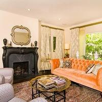 living rooms - orange, couch, tufted, curtains, rug, armchair, black, fireplace, mirror, velvet sofa, orange sofa, orange velvet sofa, chesterfield sofa, orange chesterfield sofa,