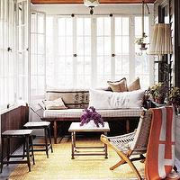 porches - French, windows, black, metal, stools, yellow, gold, rug, gray, folding chair, steel, coffee table, accent table, wood, bench, brown gray, sack, cushions, antique, pendant, orange, throw blanket,
