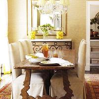 dining rooms - gold, beveled, mirror, carrara, marble, black, iron, console table, wood, dining table, linen, cotton, slipcovered, chairs, silver, chandelier, gold, silk, shades, red, orange, yellow, rug, gold, beige, grass cloth, grasscloth, wallpaper,