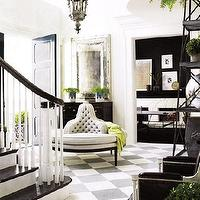 entrances/foyers - white, black, chest, silver, beveled, mirror, gray, tufted, sofa, bench, black, white, staircase, banister, spindles, black leather, chairs, nailhead trim, nail head trim, black, etagere, black, white, checkered, tiles, diamond pattern, pewter, antique, Moroccan, chandelier, pendant, black door,