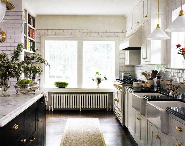 kitchens - white, subway tiles, dark grout, black, granite, countertops, black, kitchen, cabinets, white, carrera, carrara, marble, countertops, brass, pulls, fixtures, faucets, farmhouse sinks, pendant, lighting, sisal rug, runner, wood floors, beige tan walls, paint colors, kitchen,