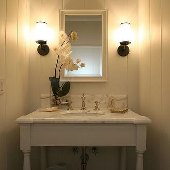 Giannetti Home - bathrooms: tiny powder room, small powder room, paneled walls, white marble top vanity, white washstand, orb sconces,  Elegant,