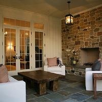 Giannetti Home - decks/patios - stone, fireplace, oil-rubbed bronze, lanterns, slipcovered, slip-covered, slipcovers, slip covers, white, sofa, chairs, pink, gray, outdoor, throw pillows, teak, accent, tables, French doors, slate, tiles, floors, veranda, patio colors,