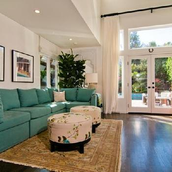 living rooms - teal sofa, teal sectional sofa, slipcovered sofa, teal slipcovered sofa, teal slipcovered sectional, oval ottomans,  Tori Spelling