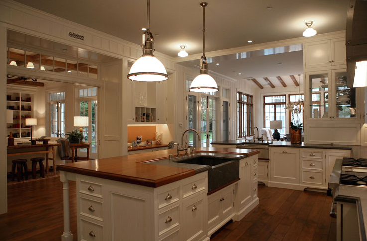 Island with butcher block top transitional kitchen House plans with large kitchen island