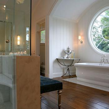 Giannetti Home - bathrooms - tub alcove, arched tub alcove, bathtub alcove, arched bathtub alcove, master bathroom, master bathroom ideas, blue velvet bench, bathroom bench, tufted bench, blue tufted bench, Oly Studio Mother of Pearl Mirror, Dresser Long Sconce,