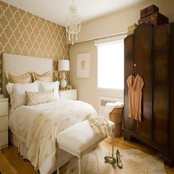 bedrooms - trellis wallpaper, moroccan wallpaper, gray moroccan wallpaper, quatrefoil wallpaper, moorish tile wallpaper, armoire bedroom armoire, french bench, wallpaper accent wall, bedroom with wallpaper accent wall, wallpapered accent wall, french chandelier, cowhide rug,