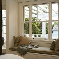 bedroom window seat, gray silk cushion and silk pillows.