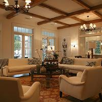Giannetti Home - living rooms - exposed, rustic, wood beams, white, elegant, sofas, chairs, blue, brown geometric, throw pillows, orange, yellow, red, rug, exposed, natural, wood, beams, iron, chandelier, sconces, stone, round, coffee table, glass top, floor lamp, glass,