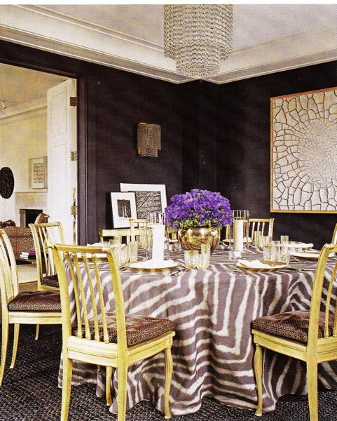 dining rooms - Hollywood regency, chandelier, sconce, sconces, dining table, yellow, wood, dining chairs, tufted, brown, cushions, black, geometric, rug, gray, white, tablecloth, art, photo gallery, French doors, black walls, purple, gray, yellow, dining room,