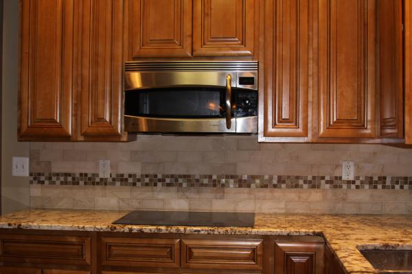 subway tiles with mosaic accents |  backsplash with tumbled